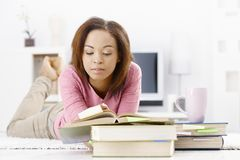 University girl studying at home Royalty Free Stock Image