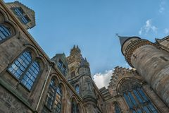 University of Glasgow, Scotland, UK. University of Glasgow, Scotland, Architecture and travel in Scotland, the tower on blue sky Stock Images