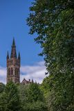 University of Glasgow, Scotland, UK. University of Glasgow, Scotland, Architecture and travel in Scotland, the tower on blue sky Royalty Free Stock Photos