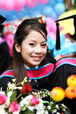 University graduate. Portrait of a beautiful Asian university graduate in robes Stock Photography