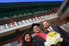 University graduate with his parents. Happy university graduate with his parents. International student from South Africa at an Asian university Royalty Free Stock Photography