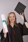 University graduate holding cap and diploma Stock Photos
