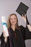 University graduate holding cap and diploma Stock Photos