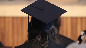 University graduate looking at stage and waiting for students receiving diplomas. Stock footage stock footage