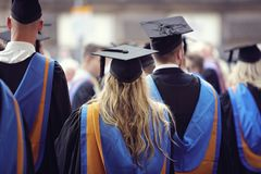 University graduates at graduation ceremony Stock Image