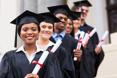 University graduates graduation. Happy group of university graduates at graduation ceremony Royalty Free Stock Photos