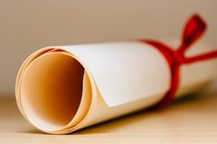 University Graduation Diploma. With Red Ribbon Stock Photography