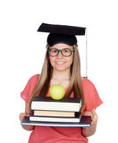 University with graduation hat and many books Royalty Free Stock Image
