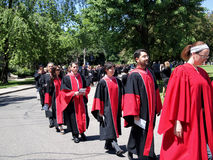 University Graduation Procession. Students gather in June at the University of Toronto for their graduation ceremony.  The red striped gowns indicate that these Stock Image