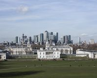 The university of Greenwich, the view of Canary Wharf. This image shows a view of a park in Greenwich. We can see Canary Wharf in the background. Canary Wharf stock photo
