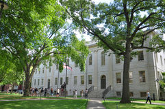 University Hall in Old Harvard Yard. Tourists in front of John Harvard Statue and University Hall on Old Harvard Yard, Harvard University, Cambridge Royalty Free Stock Photos