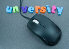 University: just a click away. A macro image of the word university in colorful lower case letters with the letter 'i' replaced by a cable connected to a stock photos