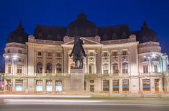 University Library in Bucharest, Romania. University Library building and King Carol I statue in Bucharest, Romania night scene royalty free stock images