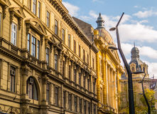 University Library in Budapest, Hungary. Charming street in the Old Town of Budapest. The yellow building with the colorful cupola is the University& x27;s stock images