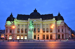 University Library, King Carol I, Bucharest. The Central University Library is located in central Bucharest with statue of Carol I, first king of Romania in Royalty Free Stock Photography