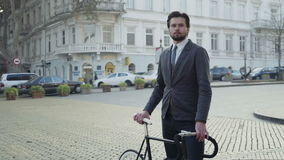 University male student standing in the street with his bicycle stock video