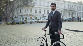 University male student standing in the street with his bicycle stock video footage