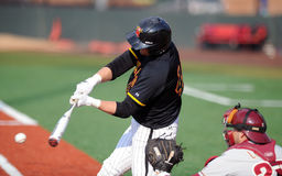 University of Maryland baseball batter connects Stock Photos