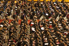 University Master's Graduates. Hundred's of graduates sit listening to the commencement exercises Stock Images