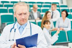 University medicine professor with competence. Giving medicine apprenticeship to doctors stock photography