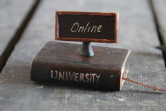 University online courses. Book - computer and inscription university, vintage style Royalty Free Stock Images