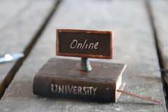 University online courses, , vintage composition. Book - computer and inscription university, vintage style Royalty Free Stock Photo
