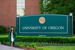 University of Oregon Female College Grad Stock Photo