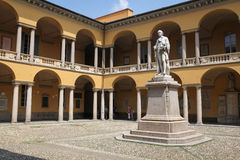 University of Pavia, Italy. Pavia, Italy – July 9, 2013: View at the courtyard of the University of Pavia in the town of Pavia, northern Italy, with a monument Royalty Free Stock Image