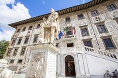 Piazza dei Cavalieri Palazzo della Carovana, Pisa, Italy. University on Piazza dei Cavalieri Palazzo della Carovana decorated with graffiti and sculptures of royalty free stock images