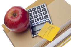 University Planning Concept. With Note, Books, Apple and Calculator royalty free stock photos