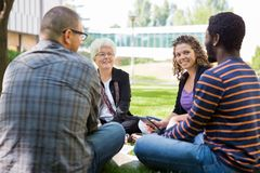 University Professor Helping Students Outdoors Royalty Free Stock Images