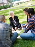 University Professor Outdoors with Students Royalty Free Stock Photography