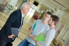 University professor talking with students. Teacher Royalty Free Stock Images