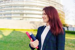 Confident young smiling student outdoors royalty free stock photo