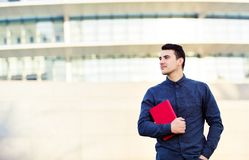 Confident young smiling student outdoors stock photography
