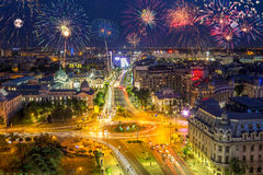 University Square in Bucharest Romania with fireworks in the sky. Fireworks show in the sky of Bucharest, capital city of Romania royalty free stock photo