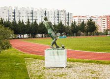 University Stadium, Lisbon, Portugal: field n. 2 and the monument to the hammer thrower. Monument to the the hammer thrower in the field n. 2 of the University Royalty Free Stock Images