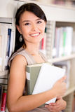 University student carrying books Royalty Free Stock Photo