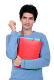 University student carrying folders Stock Image