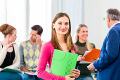 University Student in class with professor Stock Image