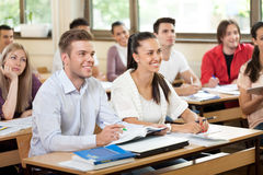 University student in classroom. Listening a lecturer Stock Photography