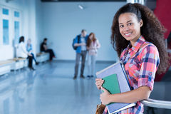 University student in college holding notes Royalty Free Stock Image