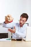 University student with empty piggy Royalty Free Stock Photo