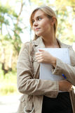 University student girl with books in the park Royalty Free Stock Images