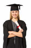 University Student In Graduation Gown Holding Certificate. Portrait of beautiful university student in graduation gown holding certificate against white stock photos
