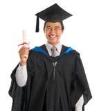 University student graduation, showing cert Stock Image