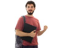 University student holding black notebook. Confident student looks at camera and poses. Young man with beard, wearing red striped shirt. White background with Royalty Free Stock Images