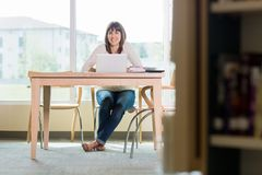 University Student With Laptop In Library Stock Photography