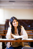 University student in lecture hall. Happy female university student in lecture hall Royalty Free Stock Photo