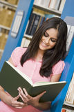 University student in library. University library studying book in library royalty free stock photos